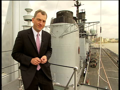 25th anniversary hms ark royal arrives in london on reporter to camera - ark stock videos and b-roll footage