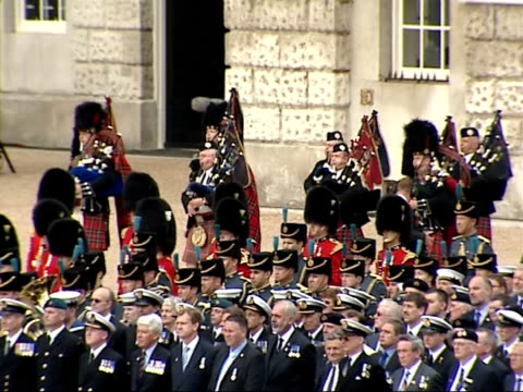 25th anniversary memorial ceremony at horse guards parade band of scots guards along as playing bagpipe music sot - bagpipes stock videos & royalty-free footage