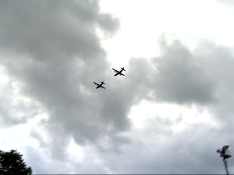 25th anniversary memorial ceremony at horse guards parade military airplanes flying through sky in formation including some leaving coloured vapour... - 25th anniversary stock videos & royalty-free footage
