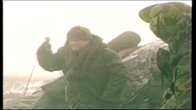 25th anniversary task force moment of surrender tx british commanding officer emerging from tent to announce 'i have just heard that the white flag... - フォークランド諸島点の映像素材/bロール