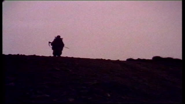 25th anniversary: the yomp: day 1; 1982 dusk silhouette of lone soldier walking on beach head - day 1 stock videos & royalty-free footage