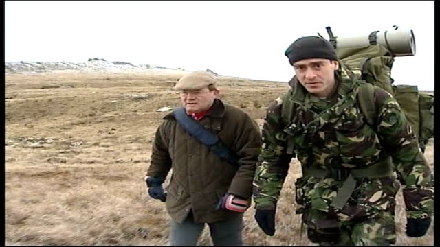 25th anniversary the yomp day 5 falkland islands en route to port stanley ext damon green to camera as walking route of 'the yomp' with richard... - day 5 stock videos and b-roll footage