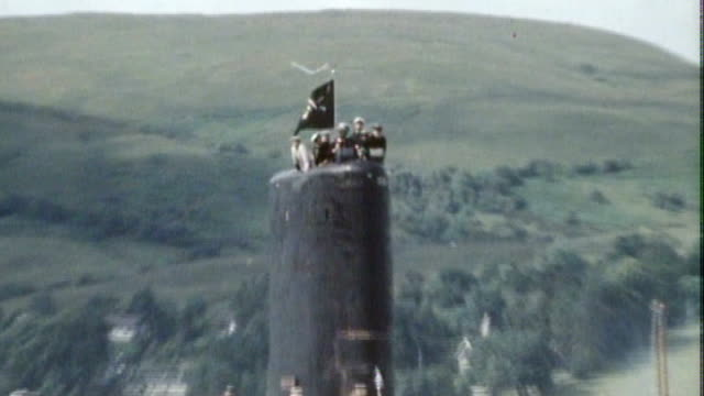 falklands war 30th anniversary: belgrano sinking: 'sonar' designer interview; lib / 116058 scotland: faslane: ext hms conqueror submarine into... - sinking stock videos & royalty-free footage