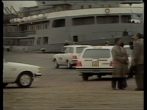 injured british soldiers arrive on hospital ship, hecla; itn uruguay: montevideo: ext hecla' bow anchored two red cross officials on deck hecla' at... - anchored stock videos & royalty-free footage