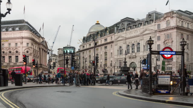 Fall afternoon time lapse of traffic along Regent St at Piccadilly Circus, featuring the entrance to the Piccadilly Circus Underground station