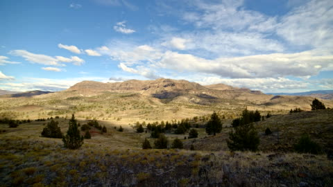 fall clouds and shadows drift over a remote desert mountain sutton mountain wide - oregon us state stock videos & royalty-free footage