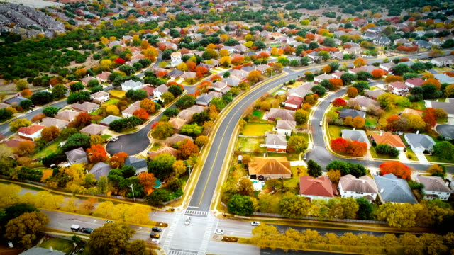 fall colors above never ending suburb housing development - modern rock stock videos & royalty-free footage