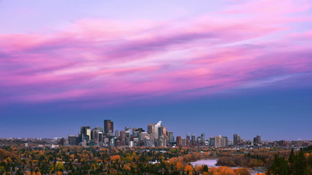 t/l fall foliage and twilight colors above calgary's skyline viewed from a great distance / calgary, alberta, canada - alberta stock videos & royalty-free footage