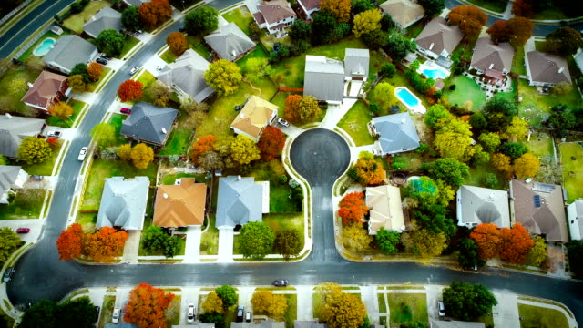 fall foliage autumn suburb neighborhood aeiral drone view high above expanding housing development - modern rock stock videos & royalty-free footage