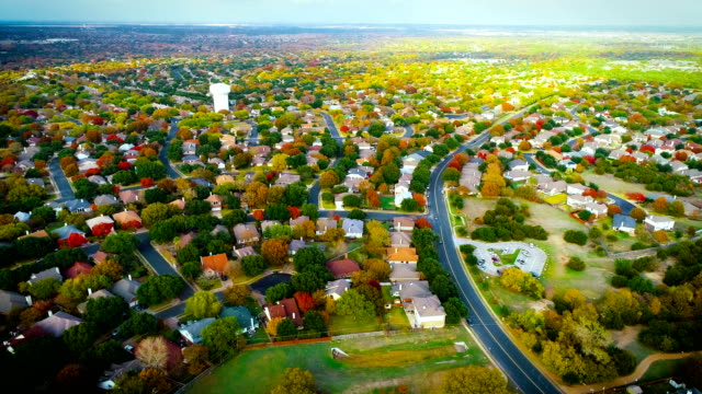 fall foliage autumn suburb neighborhood aeiral drone view high above expanding housing development lowering down - modern rock stock videos & royalty-free footage