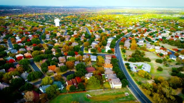 fall foliage autumn suburb neighborhood in round rock , texas expanding growing suburbia - modern rock stock videos & royalty-free footage
