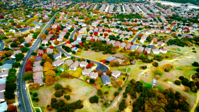 fall foliage autumn suburb neighborhood luxury living outside of the expanding austin , texas suburbia - modern rock stock videos & royalty-free footage