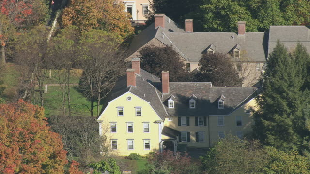 aerial fall foliage in small town with hipped-roof farmhouses / deerfield, massachusetts, united states - deerfield massachusetts stock videos & royalty-free footage