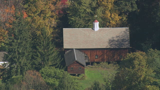 aerial fall foliage surrounding a cottage / deerfield, massachusetts, united states - deerfield massachusetts stock videos & royalty-free footage