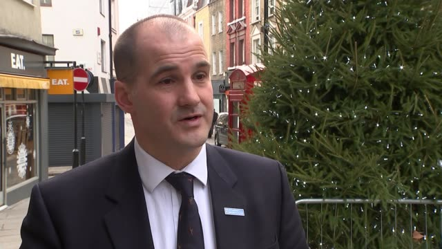 fall in number of boxing day high street shoppers; england: hampshire: aldershot: ext jake berry mp interview sot - aldershot stock videos & royalty-free footage