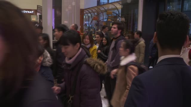 fall in number of boxing day high street shoppers england london int shoppers running into department store as doors opened at start of boxing day... - sale stock videos & royalty-free footage