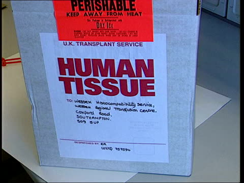 fall in number of organ donations itn 'human tissue' container on counter in laboratory as scientists around cms 'human tissue' label on container... - human tissue stock videos & royalty-free footage