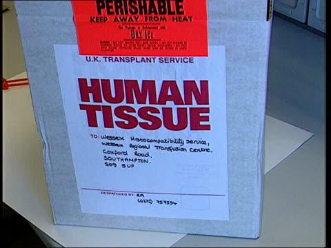 vídeos y material grabado en eventos de stock de fall in number of organ donations itn 'human tissue' container on counter in laboratory as scientists around cms 'human tissue' label on container... - tejido humano