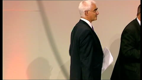fall in oil prices / alistair darling addresses tuc in brighton; darling on stage with brendan barber conference hall - 労働組合会議点の映像素材/bロール