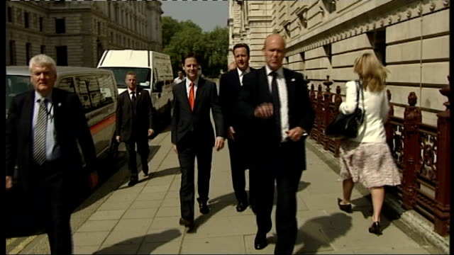 fall in support for liberal democrats: impact of newspaper cartoons of nick clegg; lib / 25.5.2010 westminster: ext tracking shot clegg and cameron... - british liberal democratic party stock videos & royalty-free footage