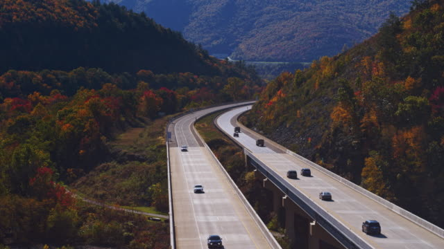 fall in the mountains. flight over the high bridge at the pennsylvania turnpike. aerial video with the forward camera motion - appalachia stock videos & royalty-free footage