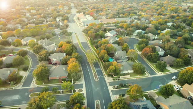 fall suburbs autumn real estate with roads leading into modern neighborhood from above - modern rock stock videos & royalty-free footage