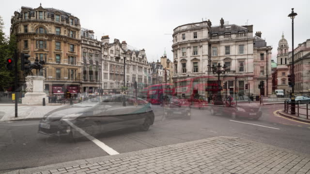 Fall time lapse of midday traffic around the Equestrian Statue of Charles I at Charing Cross to the south of Trafalgar Square in Central London