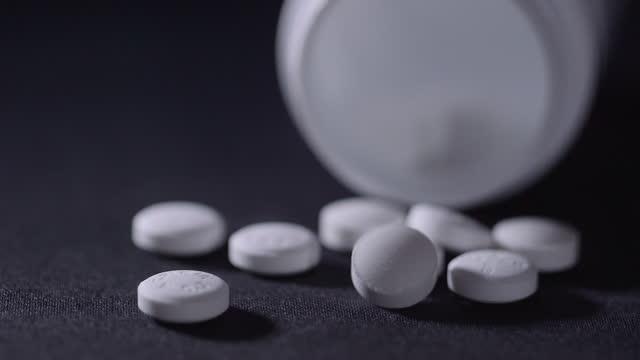 fallen medicine bottle and white pills - prescription medicine stock videos & royalty-free footage