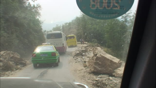 fallen rocks impede traffic on a mountain road following the 2008 sichuan earthquake in china - earthquake stock videos & royalty-free footage