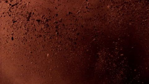 falling cocoa powder - chocolate stock videos & royalty-free footage