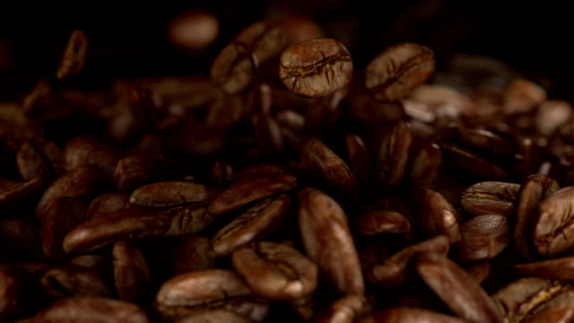 falling coffee beans - roasted coffee bean stock videos & royalty-free footage
