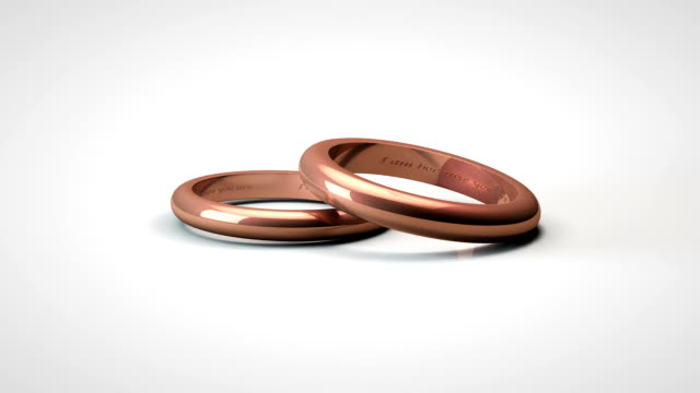falling copper gold wedding rings - jewellery stock videos & royalty-free footage