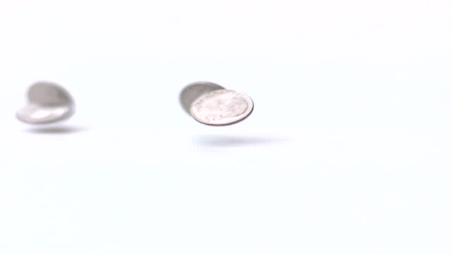 falling dimes slow motion - dime stock videos and b-roll footage