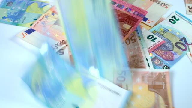 Falling Euro banknotes