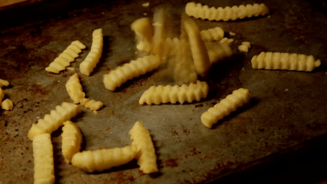 falling frozen french fries - baking tray stock videos & royalty-free footage