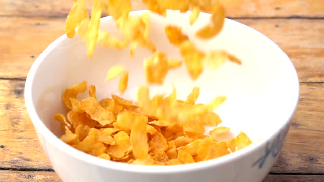 falling of corn flake in real slow motion (250 fps) - bowl stock videos and b-roll footage
