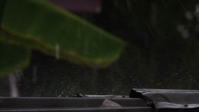 falling rain on the rooftop,slow motion - raindrop stock videos & royalty-free footage