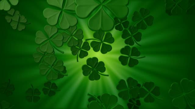 falling shamrocks - clover leaf shape stock videos and b-roll footage