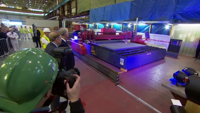fallon cuts the steel at start of production of new fleet of trident submarines england cumbria barrowinfurness bae systems int various of sir... - sheet metal stock videos and b-roll footage