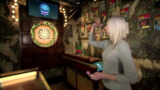 fallon sherrock throwing darts at a dartboard - championships stock videos & royalty-free footage