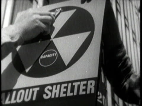 fallout shelter signs being hung - western script stock videos & royalty-free footage