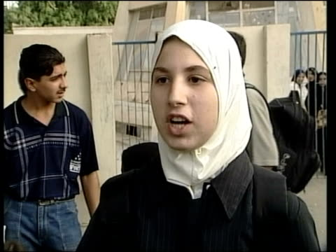 fallujah car bomb; itn girl interviewed sot translated - saying she is afraid because school is so near to police station girl interviewed sot... - al fallujah bildbanksvideor och videomaterial från bakom kulisserna