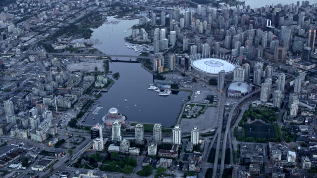 AERIAL False Creek with Downtown Vancouver at dusk