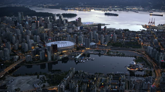 AERIAL False Creek with its surroundings and Vancouver Harbour in the background at dusk