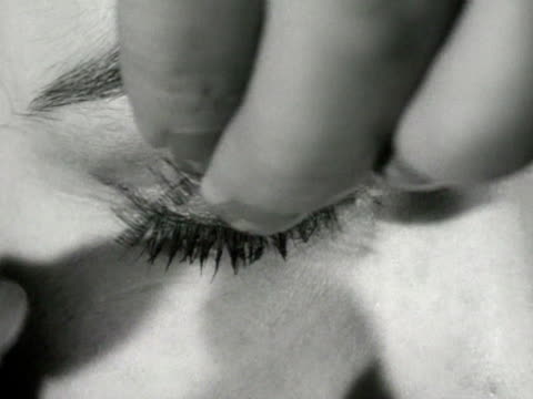 false eyelashes are applied to a model - grooming product stock videos & royalty-free footage