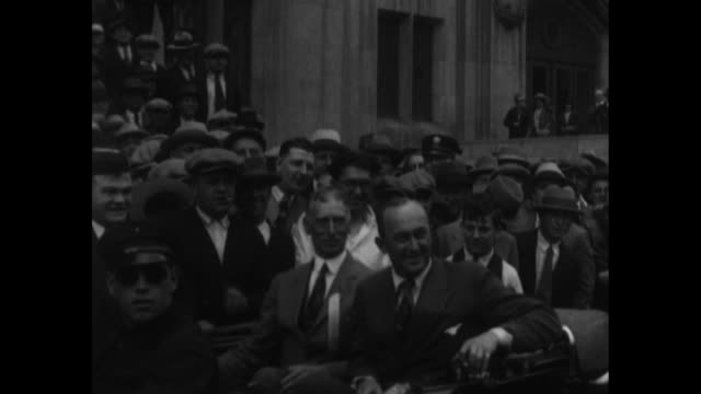 famed baseball player ty cobb and an unidentified man enter a convertible / vs a marching band passes the camera motorcycle police ride alongside... - ty cobb baseball player stock videos and b-roll footage
