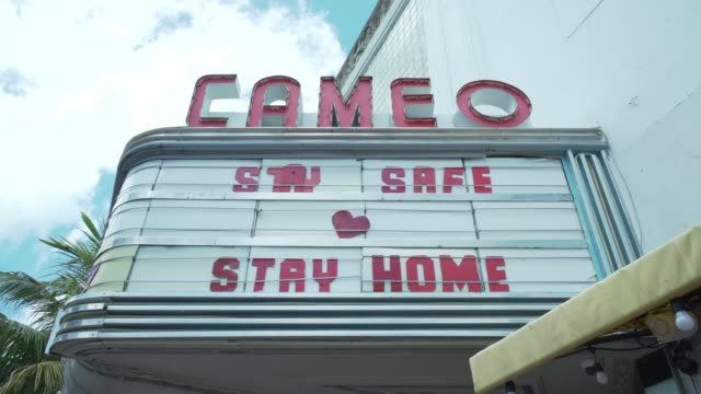 famed club cameo replaces their normal marquee that would have the next big celebrity that is coming to town with a poignant warning to residents... - theatre banner commercial sign stock videos & royalty-free footage