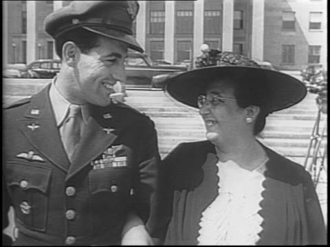 familes of captain john godfrey and captain don gentile walk down steps of pentagon / the pilots reunite with their families on the steps of pentagon... - pilot stock videos & royalty-free footage