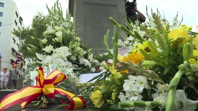 familiares de los fallecidos asociaciones de victimas del terrorismo y cuerpos policiales depositaron el jueves coronas de flores en el inicio de la... - terrorismo stock videos & royalty-free footage