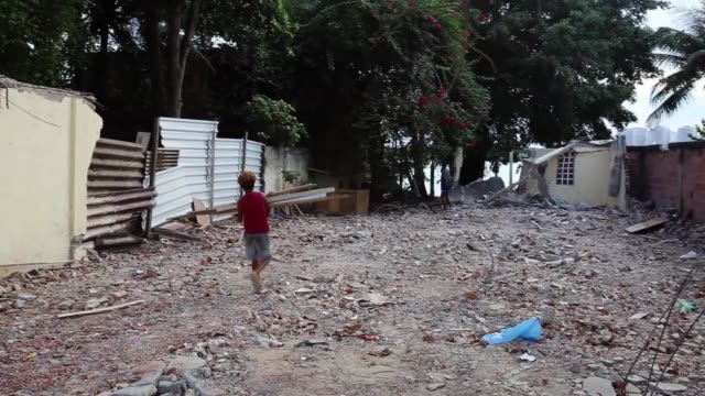 vídeos de stock, filmes e b-roll de families and entire communities are forcibly evicted from jacarepagua favela to make room for olympic developments ahead of the 2015 rio olympic... - danificado